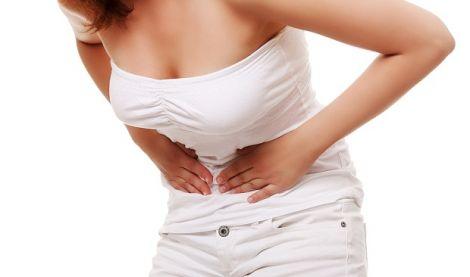 Біль у животі - один з симптомів виразки шлунка