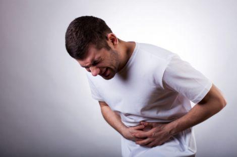 Біль  у животі - один з симптомів виразки шлунку