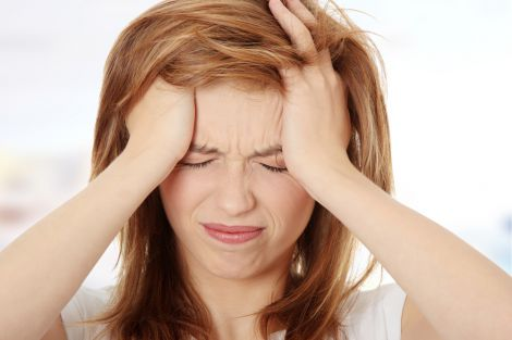 Як боротись з головним болем напруги?