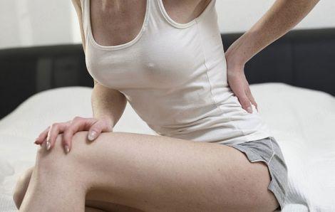 Чому у жінок болить спина?